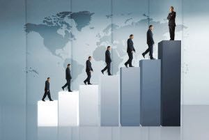 business man climbing to a graph showing his growth and success
